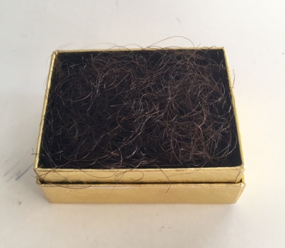 Pubic hair in gold box